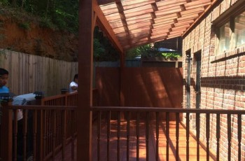 Deck with a clear corrugated roof system